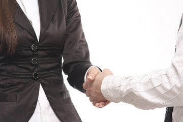 Close-up of business people shaking hands against a white