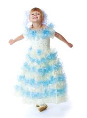 Charming little princess in a long dress.