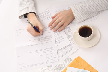 Above view of businesswoman hands working with documents at