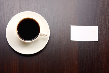 A blank and a cup of coffee viewed from above