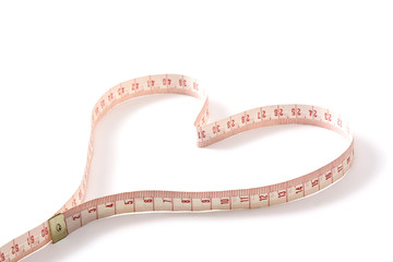 A measuring tape shaping a heart
