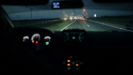 Car at the toll collection point at night