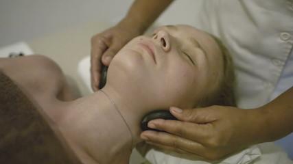 Woman under spa neck massage