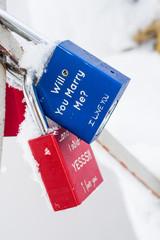 Two love padlocks attached to bridge - valentine