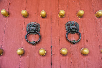 The art of Chinese temple wooden door and door knocker