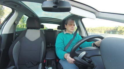 Adult Man Driving Car, inside view