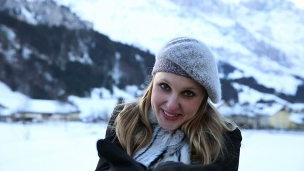 Happy pretty blonde girl on the Swiss Alpine Alps
