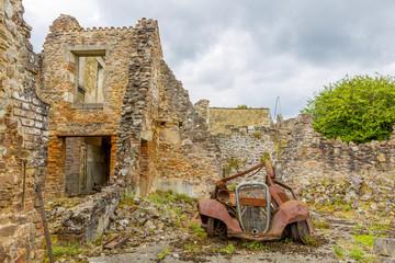 A rusty motorcar in Oradour-sur-Glane