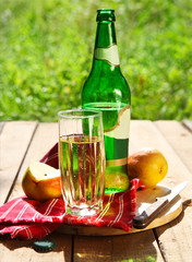 Pear cider and pears in the garden