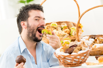 Young Men Eating Pastries