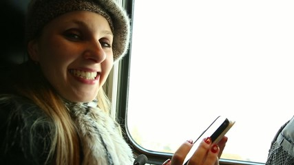 Pretty Blonde girl travels on the train