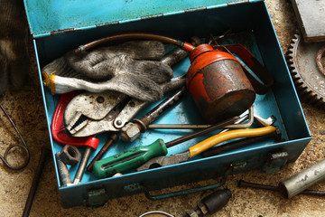 Still life with old tools in metal box