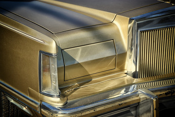 Detail on the headlight of a vintage car. retro style photo