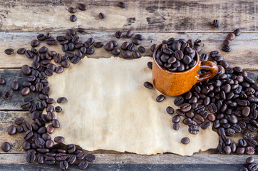 Old paper and coffee beans on wooden
