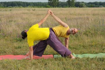 2 man doing acro yoga