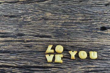 Love You on old wooden background