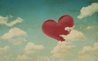 Fabric red heart on blue sky background