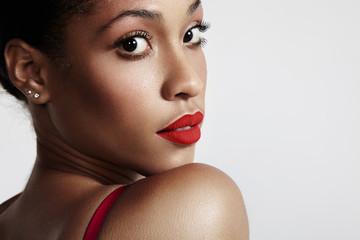 pretty black woamn watching back, wearing red matte lipstick