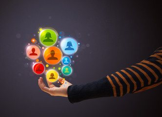 Social network icons in the hand of a woman