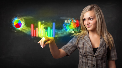 Young businesswoman touching colorful modern graph system concep
