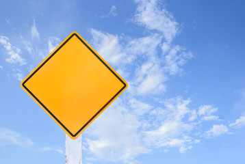 Yellow traffic sign isolated on blue sky