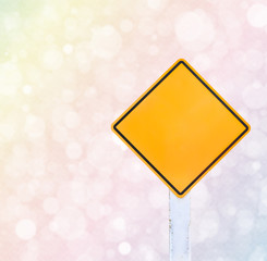 Colorful bokeh background and traffic sign