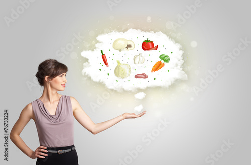 canvas print picture Pretty woman presenting a cloud of healthy nutritional vegetable