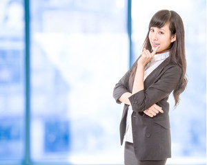 Chinese businesswoman in front of office windows