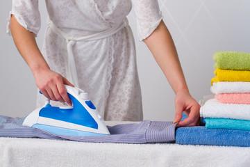 housewife   ironing shirt