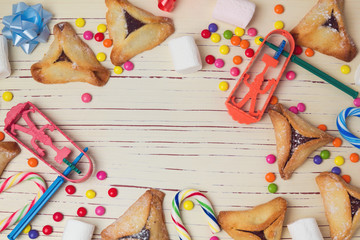 Hamantaschen cookies and candy background. View from above