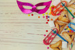 Background for Jewish holiday Purim with mask and cookies - 76735642