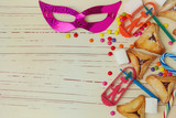 Background for Jewish holiday Purim with mask and cookies