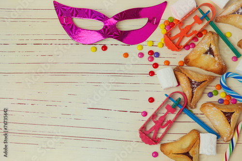 Fototapeta Background for Jewish holiday Purim with mask and cookies