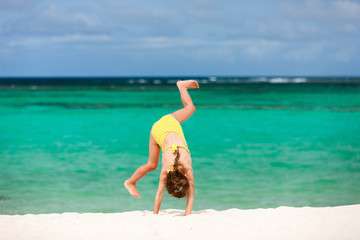 Cute little girl having fun on beach vacation