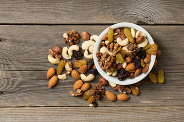 Nuts and dried fruits in a white bowl