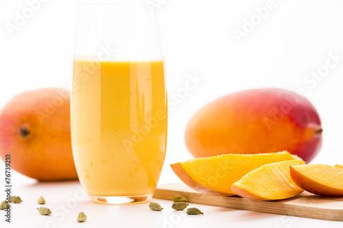 Cut Mango Pieces, Cardamon And Fruit Shake