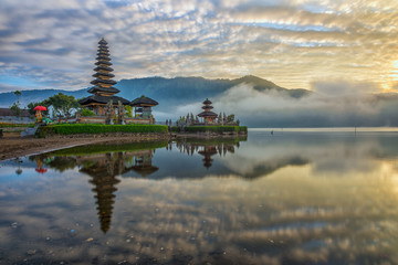 A reflection of a pura temple at sunrise