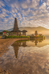 A reflection of a pura temple at sunrise - Pura Ulun Danu Bratan