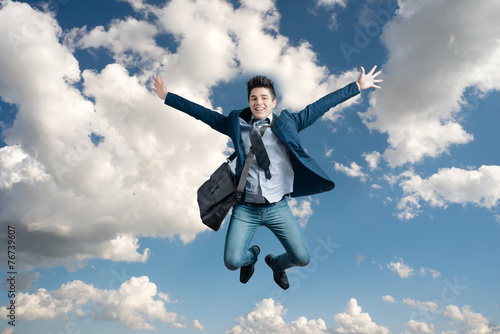 Man jumping for joy - 76739607