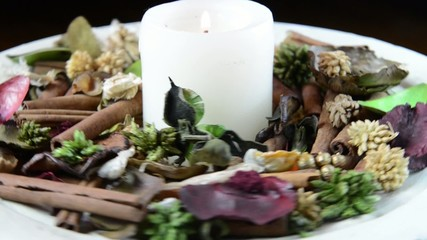 Potpourri with Cinnamon and White Candle Alight