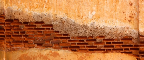 Background of cracked wall show brick inside