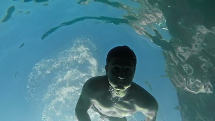 Handsome Young Swimmer Diving Underwater Diver Sun Rays Water