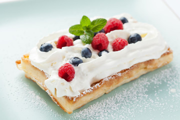 Fresh homemade brussels waffle with berries