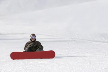 Snowboard rider sitting
