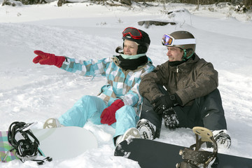 Young couple with snowboards