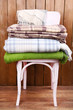 canvas print picture - warm plaids on chair on rustic wooden background
