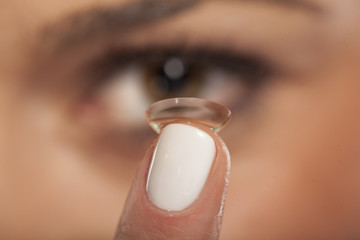 Close up of a girl inserting contact lens