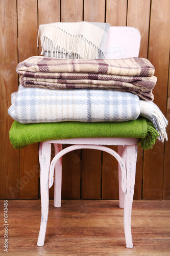 canvas print picture warm plaids on chair on rustic wooden background