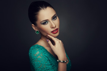Beautiful woman posing in studio on dark background