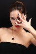 Sexy makeup woman showing her black nails gloss manicure